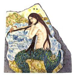 La sirenetta di Naxos che si pettina