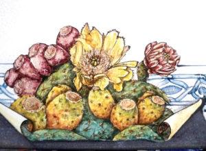Particolare di un tavolo in pietra lavica con fiori e frutti di fichi d'India
